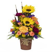 Sunflowers-carnations-lilies-and-mix-flowers-in-fall-beautiful-container